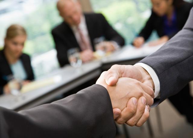 26261-cooperation-handshake1
